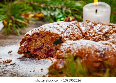 Traditional Christmas cake with dried fruits, raisins and nuts on wooden background. Close up
