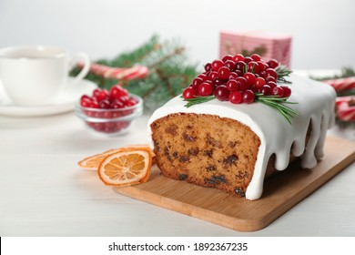 Traditional Christmas cake on white wooden table. Classic recipe