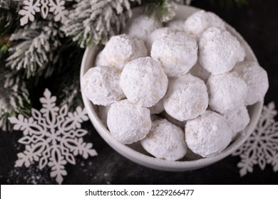 Traditional Christmas cookies with almonds snowball on dark background