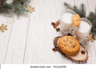 Traditional christmas cookies and milk on a white wooden background