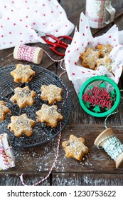 Traditional Christmas cookies with raisins on a rustic wooden background