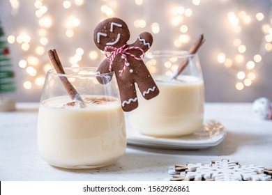 Traditional Christmas drink eggnog with cinnamon and Gingerbread man cookies