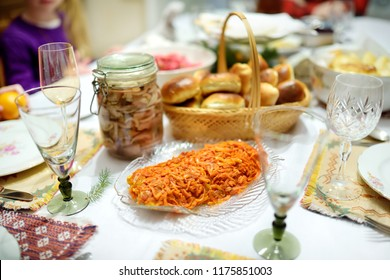Traditional Christmas Eve dinner in Lithuania, held on the twenty fourth of December. The meal is a family occasion which includes many traditions of both pagan and Christian origin.