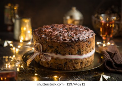 Traditional Christmas fruit cake on dark background, selective focus