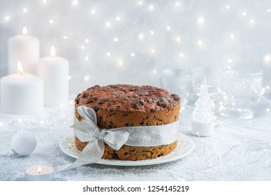 Traditional Christmas fruit cake on festive background, selective focus