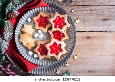 Traditional Christmas Linz cookies with star shaped jam in Christmas decorations, top view, copy space