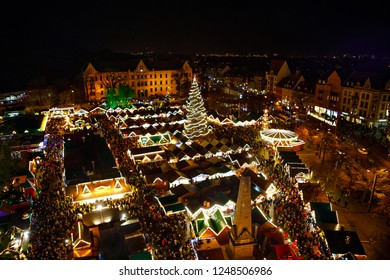 Traditional Christmas market in Erfurt, Thuringia in Germany. With xmas tree, pyramide and sales and food stands on late evening or night.