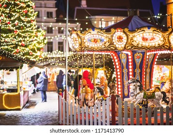 Traditional Christmas market in Europe. Carousel decorated with lights, Christmas fair concept.