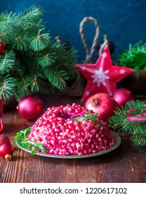 Traditional Christmas New Year salad with pomegranate seeds bracelet