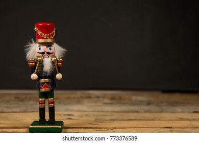 Traditional Christmas nutcracker on wooden background