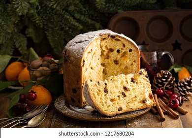 Traditional Christmas panettone with dried fruits and orange zest on rustic background