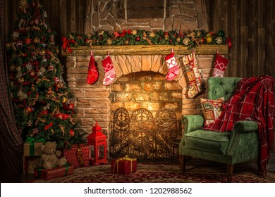 Traditional Christmas room, fireplace, armchair and Christmas tree