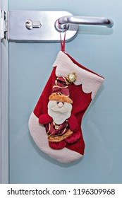 Traditional Christmas stocking hanging on door handle. Office decoration for Christmas and New year