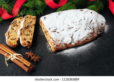 Traditional Christmas Stollen over black background