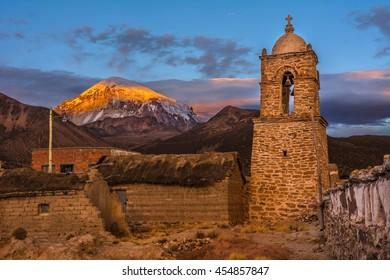 Traditional church and Sajama volcano, highest peak (6 542 m) in Bolivia
