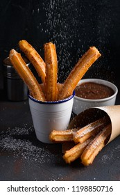 Traditional churros sticks with cinnamon sprinkling with sugar powder