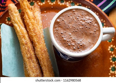 Traditional churros with sugar and chocolate