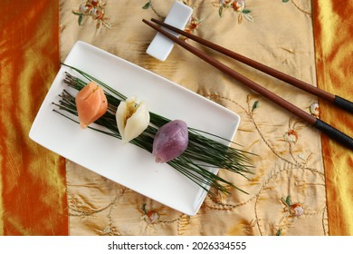 Traditional Chuseok Day Food, four colours of Songpyeon, rice cake made from Korean Rice Flour with Sesame Seed or Chopped Nuts, Honey, or Red Bean Paste.Korean Traditional Food Eaten during New Year'