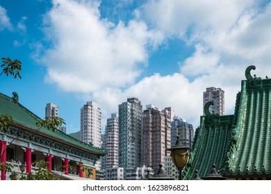 Traditional, classic Chinese temple roof and modern skyscraper architecture in HongKong