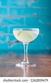 Traditional classic cocktail daiquiri, image for the menu. decorated with lime at bar background. Space for text