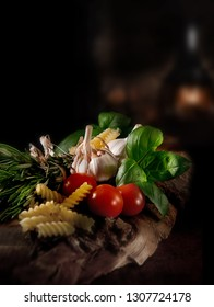 Traditional classic Italian food ingredients styled against a dark rustic background with accommodation for copy space. The perfect image for your bistro menu cover art designs.