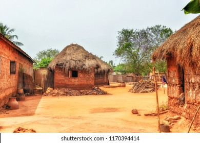 Traditional clay houses with thatched roof. African village. Rural area, Ghana