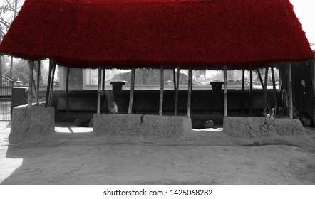 A traditional clay made house with red straw rooftop