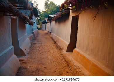Traditional clay made houses around an urban area in Bangladesh