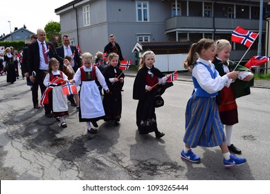 Traditional clothes - Bunad - Kids having fun in the parade - Celebration of the Constitution day 17 may - Kongsvinger, Norway (17th May 2018)