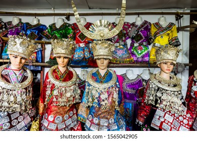 Traditional clothes on mannequins in the clothes shops of Xijiang Qianhu Miao Village (One Thousand Household Miao Village) , in Guizhou province of China.
