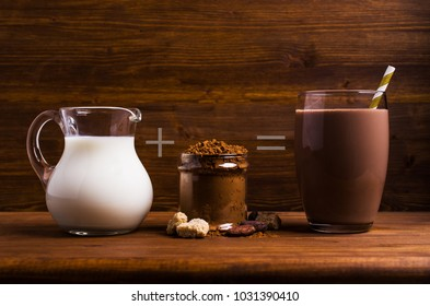 Traditional cocoa drink in glass on wooden background. Selective focus.