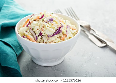 Traditional cole slaw salad in a white bowl