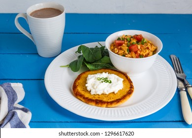 Traditional colombian breakfast huevos pericos with corn cakes