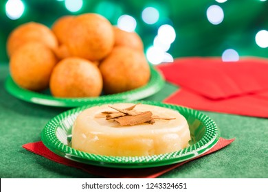 Traditional Colombian bunuelos (Deep Fried Cheese Bread) and natilla on christmas