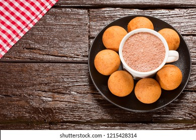 Traditional Colombian buñuelo - Deep Fried Cheese Bread. Wood table