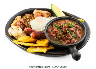 Traditional Colombian dish called Bandeja Paisa: a plate typical of Medellin that includes meat, beans, egg and plantain