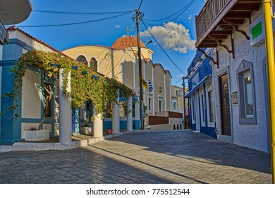 A traditional colorful alley in the port of Karpathos, Pigadia
