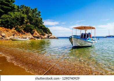 Traditional colorful boats in old town of Skiathos island, Sporades, Greece. Scenic view of aegean sea. Popular summer holiday destination scene.