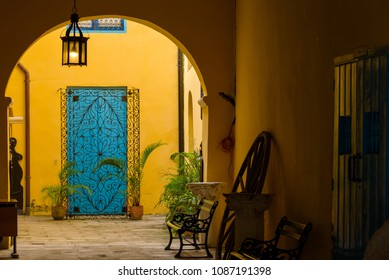 Traditional colorful Cuban architecture. Blue door facade and porch of a building. Architectural detail. Havana, Cuba