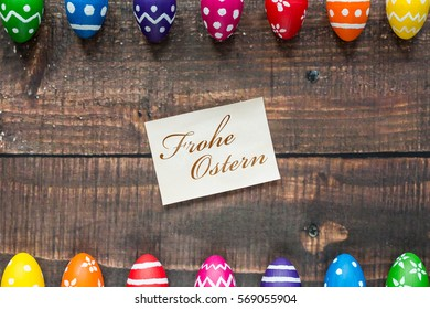 Traditional, colorful easter eggs on rustic table - Shutterstock ID 569055904