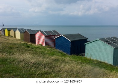 Traditional colorful English beach huts in Whitstable, Kent in the United Kingdom