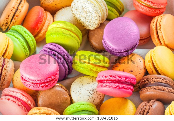 Traditional colorful french macarons are sweet meringue-based confection.
