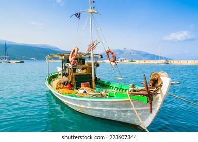 Traditional colorful Greek fishing boat in port of Sami village, Kefalonia island, Greece