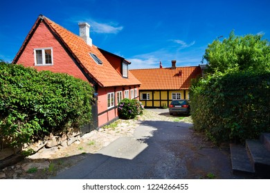 Traditional colorful half-timbered houses in Gudhjem, Bornholm, Denmark