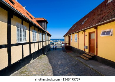 Traditional colorful half-timbered houses in the street leading towards harbor, Svaneke, Bornholm, Denmark