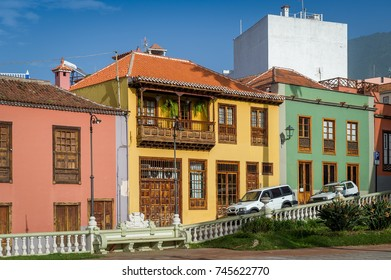 Traditional colorful houses and wooden decorated balcony. La Orotava, Tenerife island, Spain
