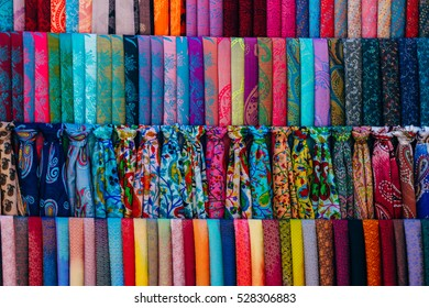 Traditional colorful silk scarfs at the bazaar stall in Bukhara, Uzbekistan, Central Asia