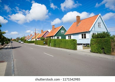 Traditional colorful wooden Swedish houses in the suburbs of Nexo, Bornholm, Denmark. The houses are the gift from Swedish state after the end of the Second World War.