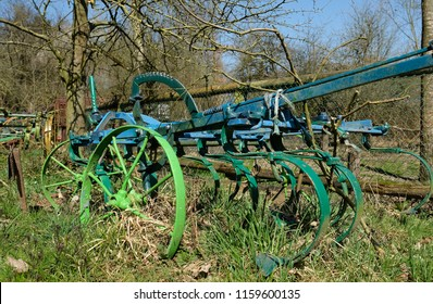 A traditional, colorfully painted plow in the farm
