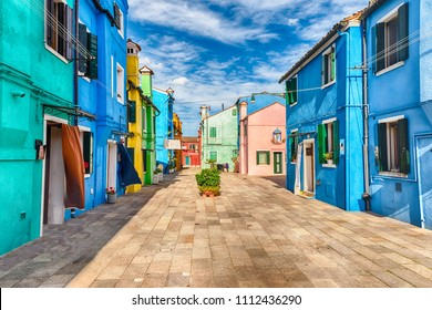 Traditional colourful painted houses on the island of Burano, Venice, Italy. The island is a popular attraction for tourists due to its picturesque architecture